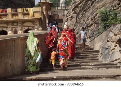 JAIPUR, INDIA - OCT 9, 2017 - Hindu women climb the steps of Galtaji temple, Jaipur, Rajasthan, India