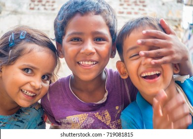 Jaipur, India - September 20, 2017: Portrait of beautiful group of children, smiling and playing in the street in Jaipur city in India