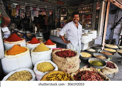 Jaipur, India - September 23, 2013 : A vendor displayed the traditional indian spices in his shop by the street.