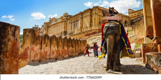 JAIPUR, INDIA, September 26, 2013: Riding elephants up to the Amber palace complex. Amber Fort is the principal tourist attraction in the Jaipur area, Jaipur, Rajasthan, India