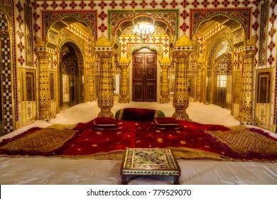 Jaipur, Rajasthan, December 11, 2017: City Palace Jaipur interior gold artwork with precious gems.