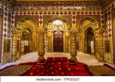 Jaipur, Rajasthan, December 11, 2017: City Palace Jaipur Rajasthan interior room with gold and precious gems artwork.