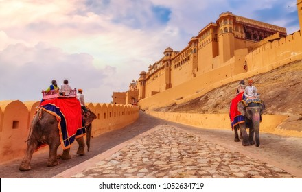 Jaipur, Rajasthan, December 12,2017: Tourists enjoy elephant ride at Amber Fort Jaipur at sunrise.