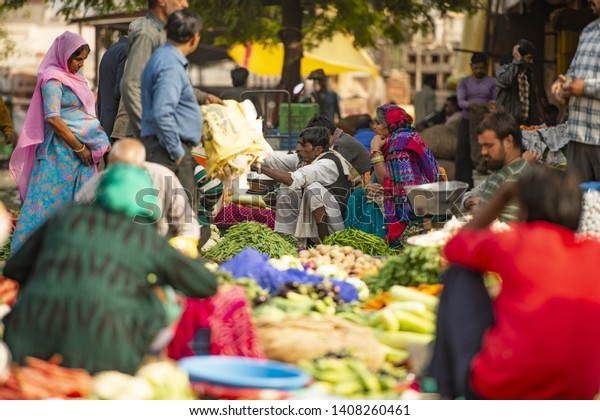 JAIPUR- RAJASTHAN - INDIA - 01 DECEMBER 2017. Customers and traders in a street market in Jaipur. Jaipur is the capital and the largest city of the Indian state of Rajasthan, India.