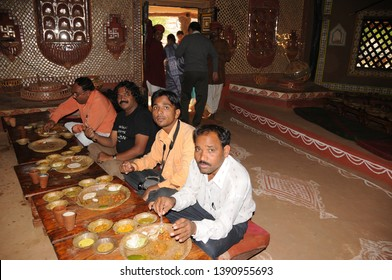 JAIPUR, RAJASTHAN, INDIA 29 NOVEMBER 2016 :  Bride and Grooms relatives and guests eating delicious food together and enjoying traditional marriage ceremony in Rajasthan.