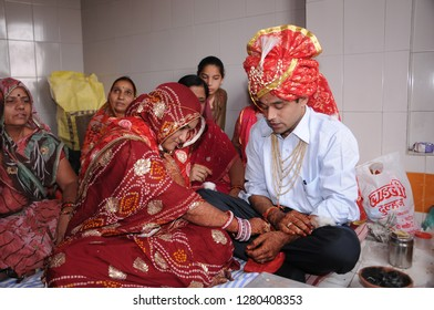 JAIPUR, RAJASTHAN, INDIA 5 DECEMBER 2017 : Unidentified Indian Groom and brides relatives doing wedding rituals at the groom's house. Traditional Indian wedding ceremony in Rajasthan