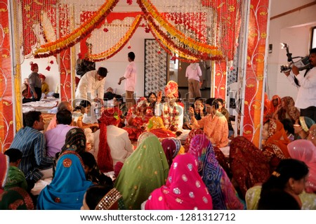 630c2f9058 JAIPUR, RAJASTHAN, INDIA 5 DECEMBER 2017 : Unidentified Indian groom and  bride doing wedding