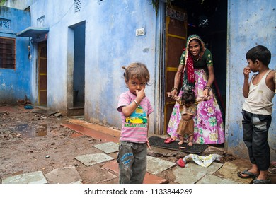 Jaipur, Rajasthan, India - August 14, 2012. A woman with her children stand outside their house at a village near the city of Jaipur in Rajasthan.