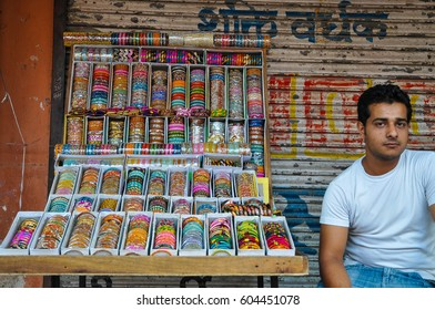 Jaipur, Rajasthan, India - Circa October 2010 - Portrait of an unidentified local man selling colourful bangles by the street