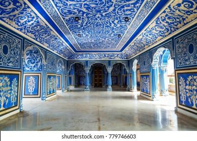 Jaipur, Rajasthan, India, December 11, 2017: City Palace Jaipur inner hallway with decorative wall art paintings.
