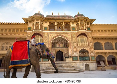 Jaipur, Rajasthan, India, December 11,2017: Decorated Indian elephant in front of Amer Fort Palace Jaipur intricately carved gateway. Amber Fort is a UNESCO World Heritage site.