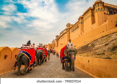 Jaipur, Rajasthan, India, December 11,2017: Tourists ride decorated elephants at Amber Fort Jaipur, Rajasthan. Amer Fort is a UNESCO World Heritage site.