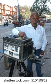 JAIPUR, RAJASTHAN, INDIA - FEBRUARY 26, 2006: Traditional photographer on the streets of the city