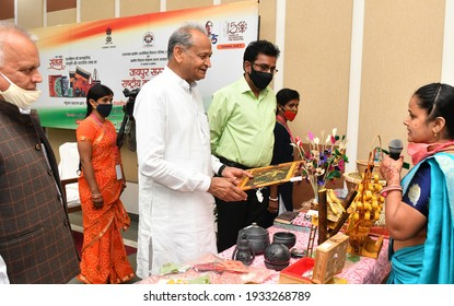 Jaipur, Rajasthan, India, March 10, 2021: Rajasthan Chief Minister Ashok Gehlot interacts with an artist of Woman Self Help Group after inaugurates National Craft Fair at Ramleela Ground in Jaipur.