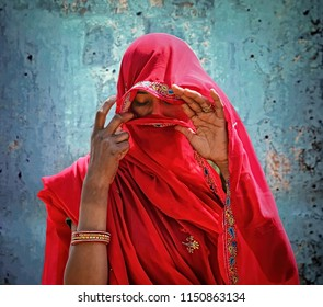 Jaipur, Rajasthan, India -  March 14, 2014 : A beautiful Rajasthani Indian woman in veil