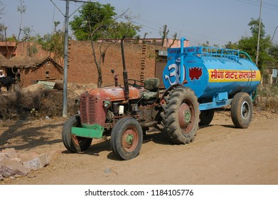 Jaipur, Rajasthan, India - march 24, 2006: Tractor with trailer of a vat of water standing on the side of the road to the village of Nayla Fort