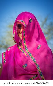 Jaipur, Rajasthan, India - March 24, 2014 : Portrait of an unidentified beautiful Indian woman who smiles in her veil.