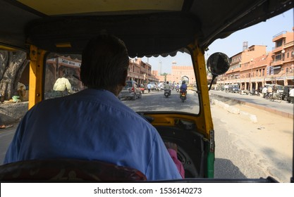 Jaipur, Rajasthan, India, October 19, 2019. A unidentified driver is riding an auto rickshaw through the busy streets of Jaipur. The auto rickshaw is a three-wheeled passenger cart used in Asia.