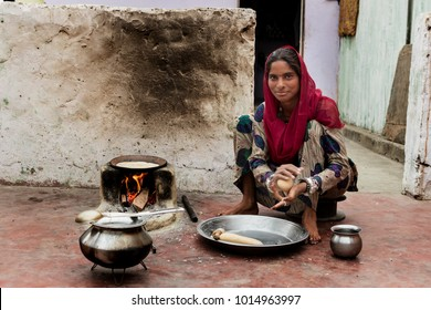Jaipur,India-March 9, 2107: Unidentified Indian woman prepare food in a small courtyard of her house.