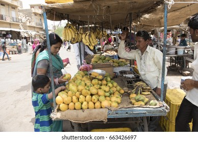 Jaisalmer/ India 9 June 2017 An Indian street vendor selling fruits on his fruit cart at Jaisalmer city market in  Rajasthan India