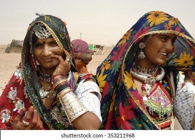 JAISALMER, INDIA - Aug.12,2007: Rajasthani tribal women who dress in vibrant coloured dress and use lots of jewels