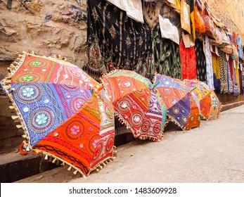 Jaisalmer, India - Circa March, 2018. Street shop with clothes and umbrellas in Jaisalmer.