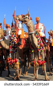 JAISALMER, INDIA - FEB 01:Traditionally dressed border security people ride camels to  attend a cultural procession for the Desert festival held on February 01, 2015 in Jaisalmer, Rajasthan, India.