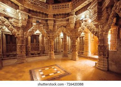 JAISALMER, INDIA - Feb 1: Columns with stone reliefs in Indian temple wall with Jain motifs on February 1, 2016. Jaisalmer has a population of about 78,000.