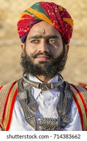 JAISALMER, INDIA - FEBRUARY 08, 2017 : Indian men wearing traditional Rajasthani dress participate in Mr. Desert contest as part of Desert Festival in Jaisalmer, Rajasthan, India. Close up