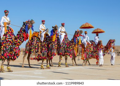 JAISALMER, INDIA - FEBRUARY 09, 2017 : Camel and indian men wearing traditional Rajasthani dress participate in Mr. Desert contest as part of Desert Festival in Jaisalmer, Rajasthan, India