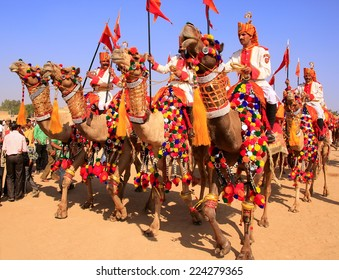 JAISALMER, INDIA - FEBRUARY 16: Unidentified men take part in Desert Festival on February 16, 2011 in Jaisalmer, India. Main purpose of Festival is to display rich and colorful culture of Rajasthan
