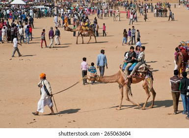 JAISALMER, INDIA - MAR 1: Traditional desert safari and many visitors of outdoor celebration during the rural Desert Festival on March 1, 2015. Every winter Jaisalmer takes the famous Desert Festival