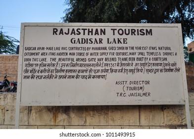 Jaisalmer, India - Mar 3, 2012. Information board of Gadisar Lake in Jaisalmer, India. Gadsisar Lake is an artificial lake built by Raja Rawal Jaisal.