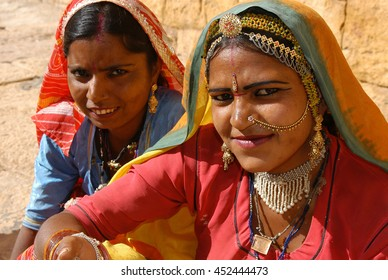 JAISALMER, INDIA - MARCH 12, 2006: Dancers resting on the door of the fort of Jaisalmer