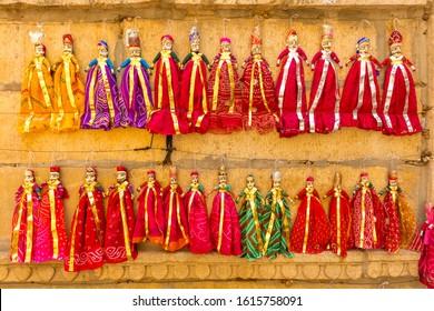 JAISALMER, INDIA, MARCH 15, 2017: Hand made wooden dolls for sale near Patwon-ki-haweli, in the desert city of Jaisalmer in India