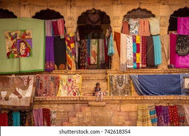 JAISALMER, INDIA - MARCH 2017: Girl Sit by the Street Market in Jaisalmer Fort, India