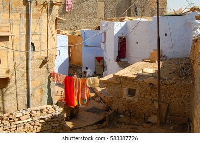 Jaisalmer, INDIA - NOV 23, 2015: View from a house roof in the streets of Jaisalmer. A look into the typical life of the Indians.