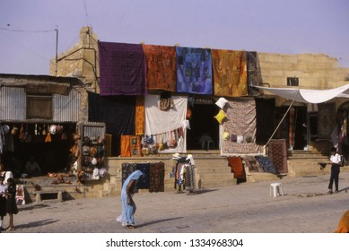 JAISALMER, INDIA - NOV 3, 2003 - Colored quilted textiles for sale outside city wall,Jaisalmer, India