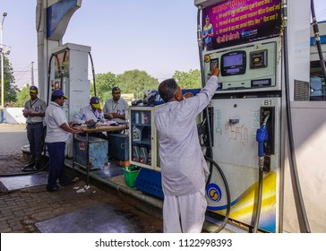 Jaisalmer, India - Nov 8, 2017. People at gasoline station in Jaisalmer, India. Jaisalmer is a former medieval trading center and a princely state in Rajasthan.
