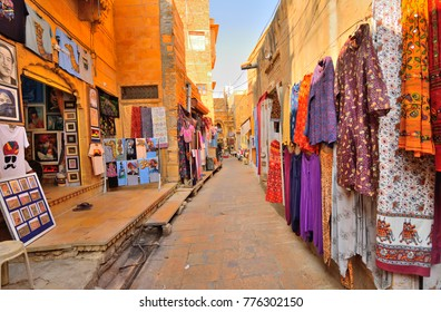 Jaisalmer, India - November 08, 2017: Colorful clothing items displayed by the shops in the streets.