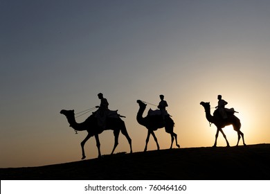 JAISALMER, INDIA, November 2, 2017 : Caravan of camels in the sand desert. Several safaris in the desert are organized for the tourists by local operators.