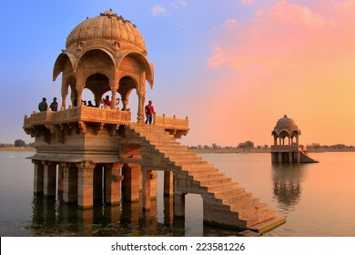 "JAISALMER, INDIA-FEBRUARY 15: Unidentified people stand at Gadi Sagar temple on February 15,2011 in Jaisalmer, India. Jaisalmer is called ""Golden City"" because of yellow sandstone used in architecture"