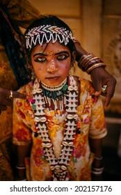 JAISALMER - MARCH 22 : unidentified child posing in the street on March 22 , 2014 in Jaisalmer,India