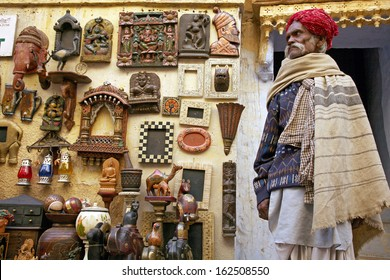 JAISALMER, RAJASTHAN, INDIA - DEC. 06: unidentified saler on shopping street in the fort of Jaisalmer December. 6, 2006 in Jaisalmer, Rajasthan, India. Early morning in the eastern city.