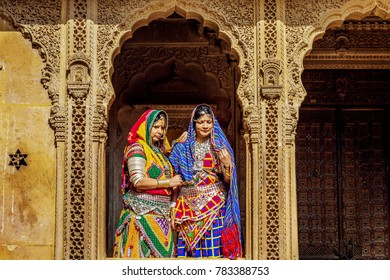 Jaisalmer, Rajasthan, India, December 14,2017: Female tourists dressed in traditional Rajasthani outfit and jewelery pose at Patwon ki haveli heritage building Jaisalmer.