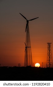 JAISALMER, RAJASTHAN, INDIA - oct 15, 2011 : wind turbines near the Bada Bagh tombs, near Jaisalmer.on oct 15, 2011.  The new India alongside traditions and history.