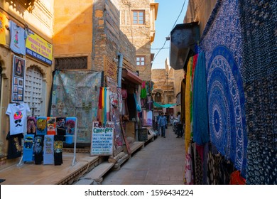 Jaisalmer, Rajasthan, India - October 13, 2019 : Pashmina shawls are being sold in market place Inside Jaisalmer Fort or Golden Fort, in the morning light. UNESCO world heritage site at Thar desert.