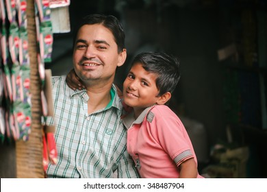 Jaisalmer,India - November 10,2015 happy dad with son in grocery store Jaisalmer,India