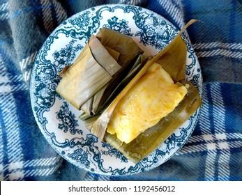 Jaje Sumping Bali. Kue basah khas bali or Balinese specialty cakes. cake wrapped in banana leaves. traditional indonesian culinary food. Indonesian Street Food.