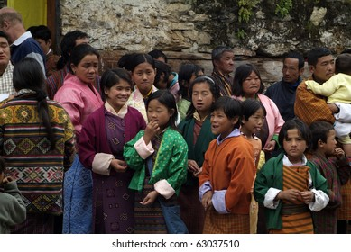 JAKAR, BHUTAN-SEPTEMBER 26: spectators and dancers at religious ceremony - smokie and fire- at the Thangbi Lhakhang in the Choekhor Valley on september 26, 2007 in Bhumtang, Bhutan